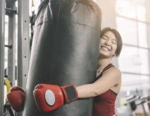 Teen fitness classes in Hong Kong girl in a boxing class